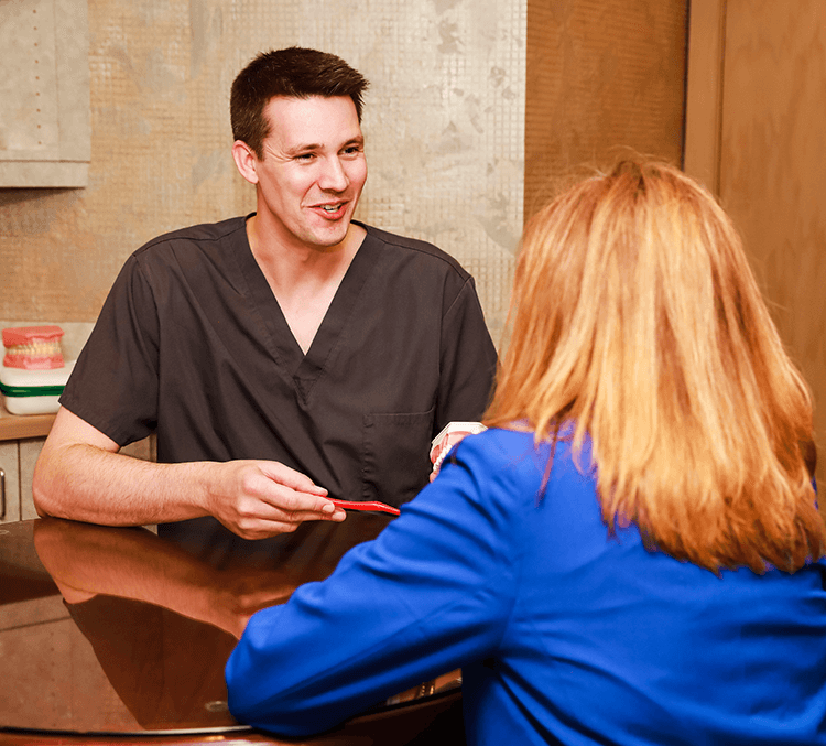 Green Bay Family Dentist, Dr. Adam Koch D.D.S. with woman patient