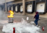 Man using fire extinguisher during Code 3 Safety & Training Fire extinguisher training