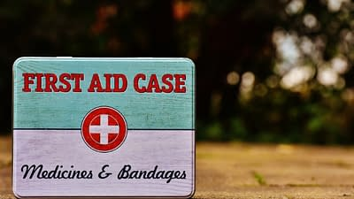 first aid case with medicine and bandages