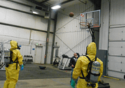Men in Hazmat suits playing basketball