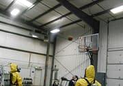 Men in Hazmat suits playing basketball