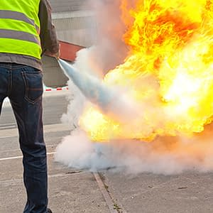 Code 3 Safety & Training instructor teaching proper use of fire extinguishers