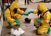 Hazmat crew testing unknown chemicals during training course