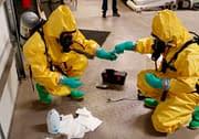 Hazmat crew testing unknown chemicals during training course
