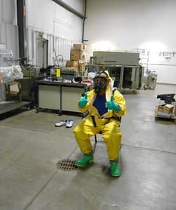 Hazardous materials training instructor in hazmat suit