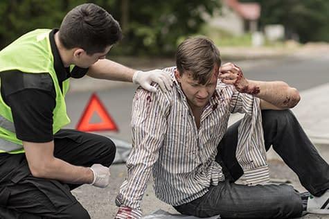 Injured pedestrian being taken care of by safety worker