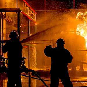 Firefighters putting out fire at plant