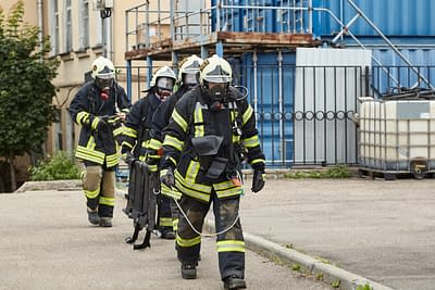 Firefighters carrying ladder to training
