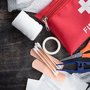 first aid kit laid out on table