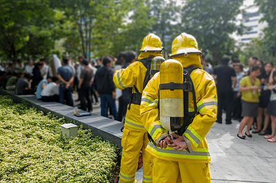 Firefighters waiting outside with evacuees