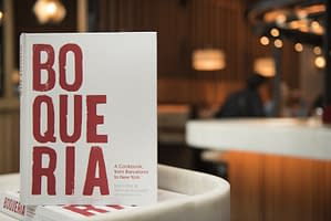 Spanish cookbook from executive chefs Marc Vidal and Yann de Rachefort upright on a table