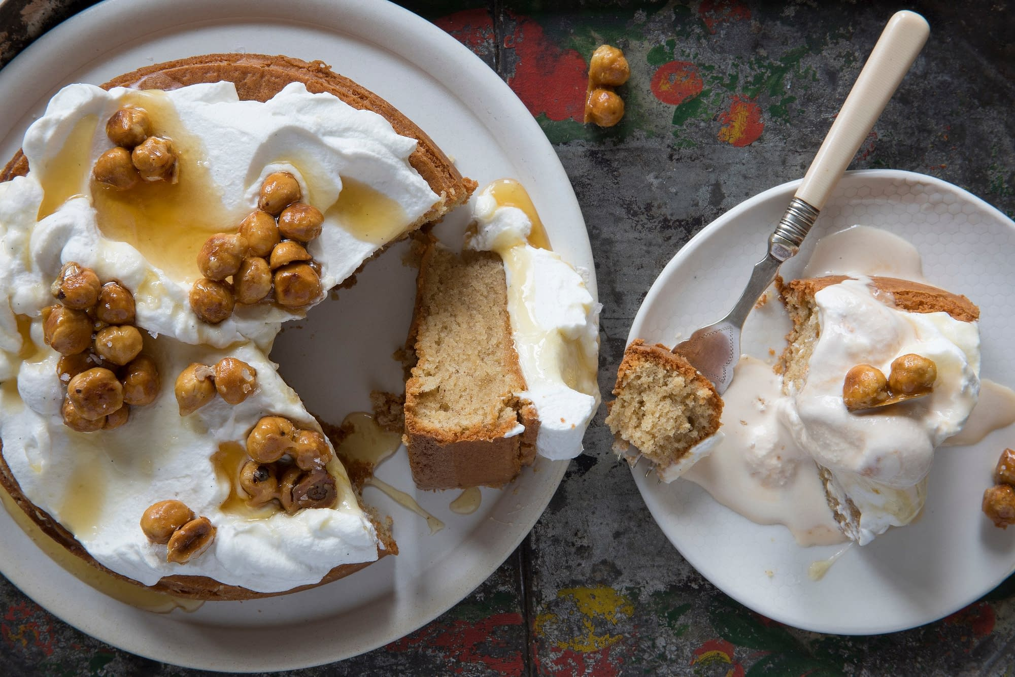 Almond hazelnut cake served on white plates from Boqueria Spanish restaurant and tapas bar in Washington DC and New York City.