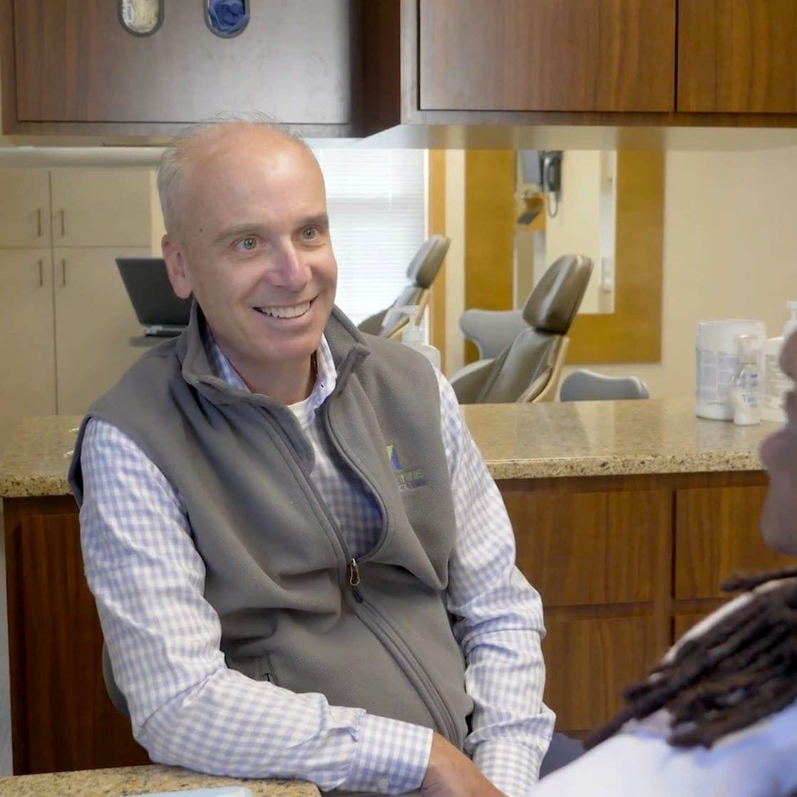 Dr. Vermette smiling at a patient