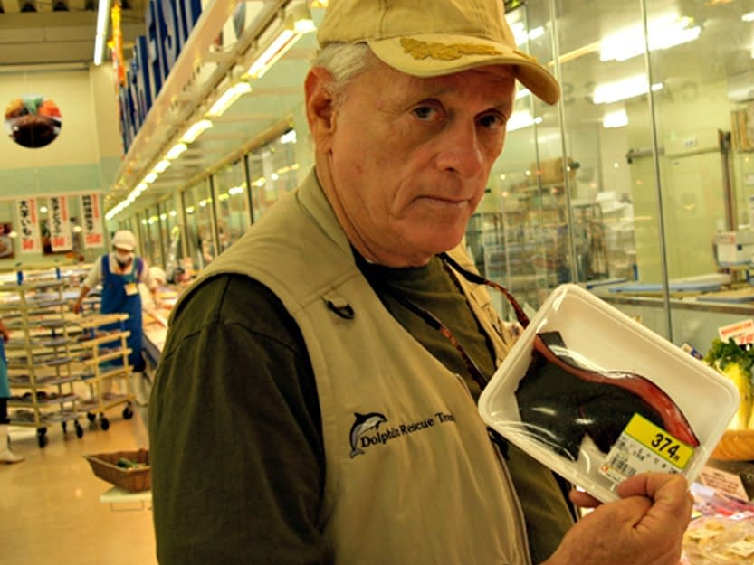 """Ric O'Barry with dolphin meat for sale, but labeled as """"Whale"""" meat, in Japanese Supermarket"""