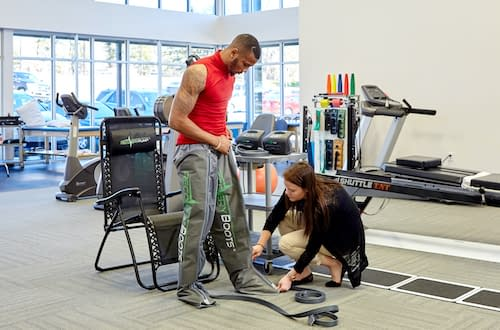 Patient receiving physical rehab therapy from an orthopedic doctor at Azalea Orthopedics.