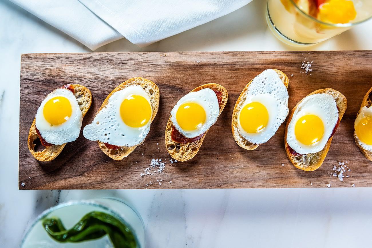 Cojonudo - Quail's eggs and chorizo on toast